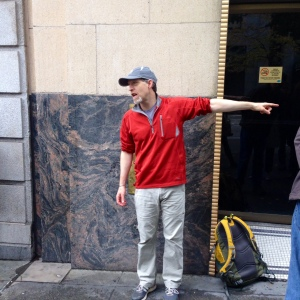 David B. Williams talks Seattle geology in front of the Exchange Building's 3.54 billion-year-old gneiss feature.
