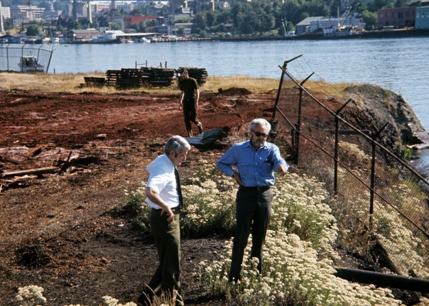 Maylor Uhlman surveying the site while Haag explains his plans, Seattle, 1974.