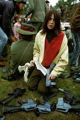 June 1971, Washington, DC, USA --- Peace activists surround themselves with broken plastic guns at a 1971 Vietnam War protest. --- Image by © Owen Franken/CORBIS