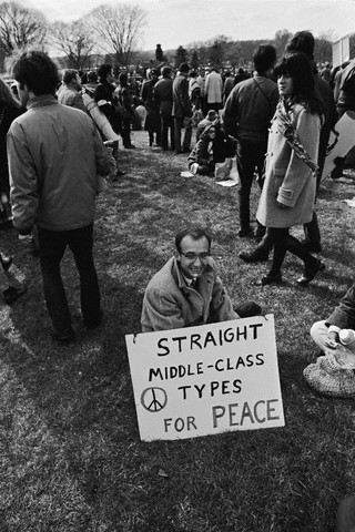 "Nov. 15, 1969, Washington, DC, USA --- An anti-Vietnam War demonstrator holds a sign that reads ""Straight Middle-Class Types for Peace"" during a rally in Washington DC. --- Image by © Leif Skoogfors/CORBIS"